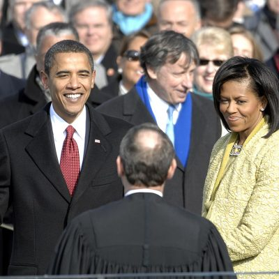 John Boehner, Barack Obama, Michelle Obama, Paul Pelosi standing next to a man in a suit and tie