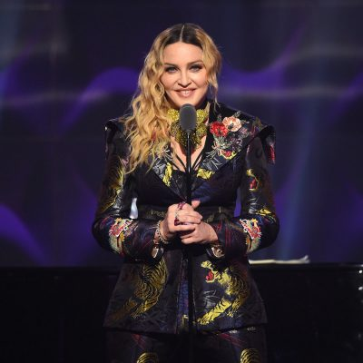 Madonna standing in front of a stage